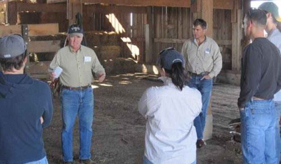 Dr. Bullock speaking in barn